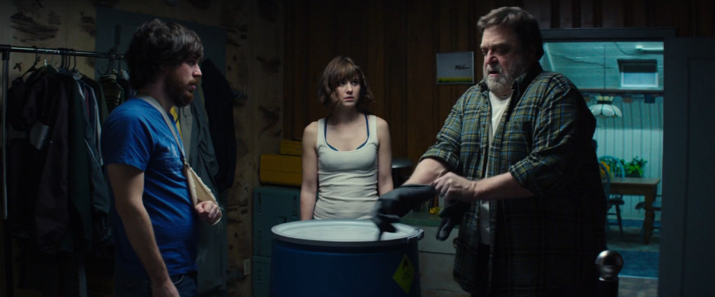 "John Gallagher, Jr,, Mary Elizabeth Winstead, and John Goodman star in ""10 Cloverfield Lane,"" here reviewed by film critic James Frazier."