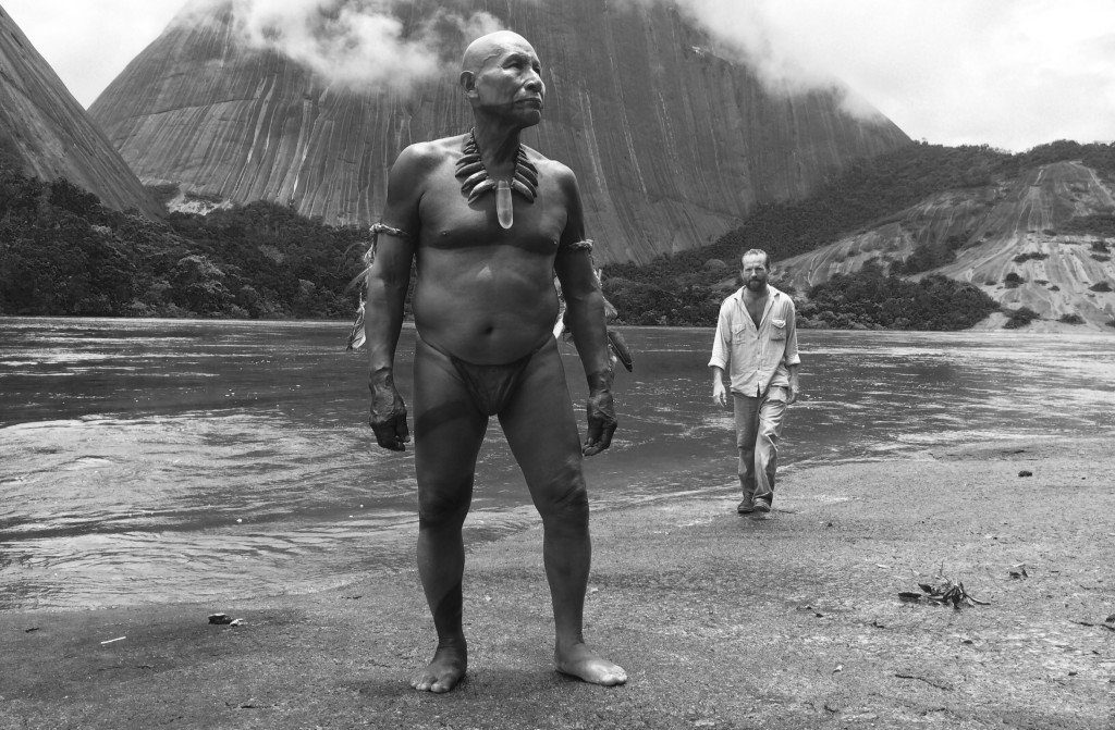"Antonio Bolívar Salvador and Brionne Davis are among the stars of Ciro Guerra's ""Embrace of the Serpent,"" here reviewed by film critic Britta Hanson."