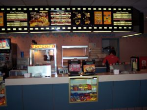 Somewhat miraculously, the concession stand was never overtaken by digital signage. In the early '90s, AMC also experimented with a coffee bar that was later abandoned for expanded arcade games. (Photo credit: Danny Baldwin)