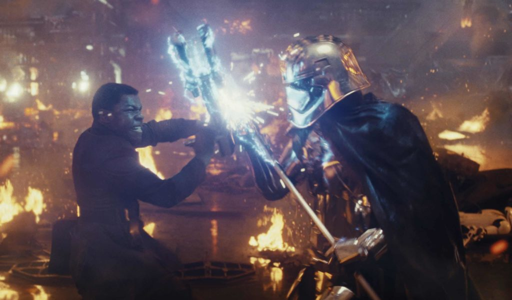 Finn and Captain Phasma duel in Star Wars: The Last Jedi.